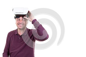 Man with virtual reality glasses on his head on white background with side copy space