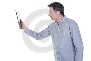 Handsome middle aged man using a digital tablet on white background