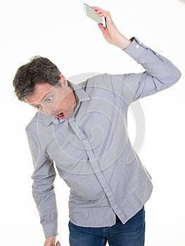 Angry caucasian man frustrated and furious with his phone conflict with customer service over white background