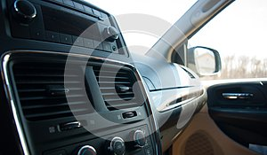 Black car interior with radio and glove compartment