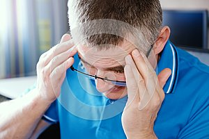 The man with glasses suffers from depression . Problems in personal life and at work. Stress and depression. Migraine is a