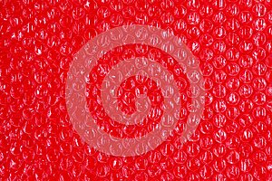 Plastic background texture cellophane wrapping packing wrap packet bead ball red berry blood bloody brilliant color