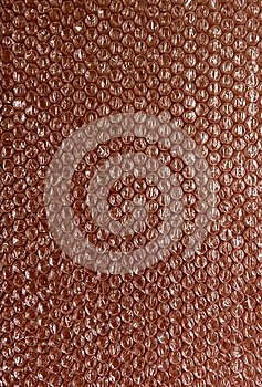 Plastic background texture cellophane wrapping packing wrap packet bead ball color maroon bordo brown chocolate