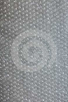 Plastic background texture cellophane wrapping packing wrap packet bead ball white black gray metal silver