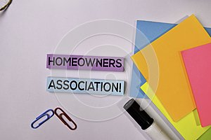 Homeowners Association! on sticky notes isolated on white background