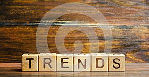 Wooden blocks with the word Trends. Main trend of changing something. Popular and relevant topics. New ideological trends of