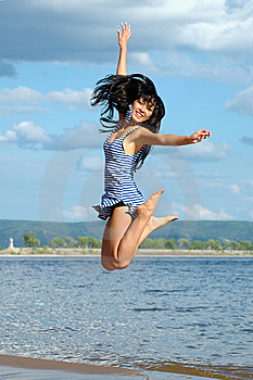 The happy jumping woman