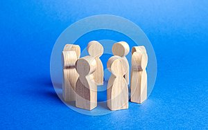 People figurines stand in a circle. discussion, cooperation. Employees briefing. Organization of work and processes. Meeting