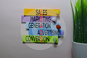 Sales, Marketing, Generation, Advertising, Conversio LEADS text on sticky notes isolated on office desk