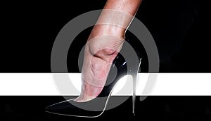 High heel. Fashion. Female foot in a black shoe. High Fashion Week. High rise of the foot. Elegant female legs