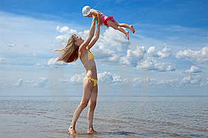 Mother and baby have fun on the beach