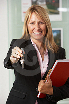 Female Estate Agent Handing Over Keys