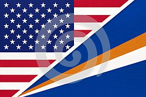 USA vs Marshall Islands national flag from textile. Relationship between american and Oceania countries