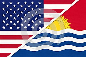 USA vs Republic of Kiribati national flag from textile. Relationship between american and Oceania countries