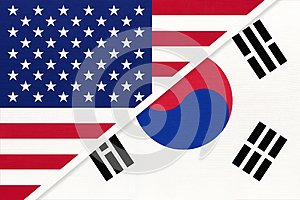 USA vs South Korea national flag from textile. Relationship between two american and asian countries