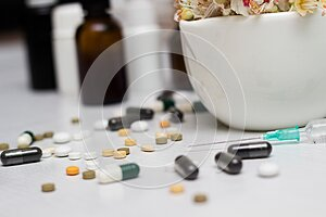 Medications and tablets with green herb