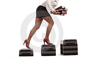 Businesswoman running up with dumbbells