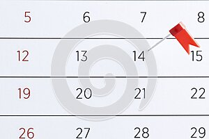 Red pin flag on a calendar. Important date. Place for text.