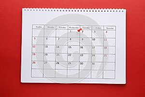 Planning calendar with pin 1х On a red background. Important date. Place for text
