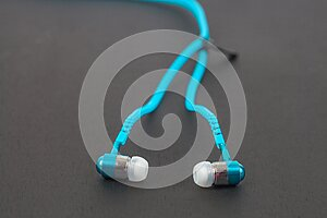 blue earphone and cable line zipper