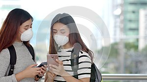 Asian teenager backpackers wearing protective PM 2.5 mask