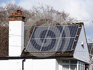 Residential solar panels on rooftop used to generate electricity