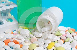 Colored antibiotics and drugs on blue background