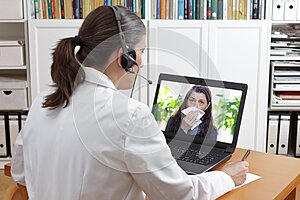 Telemedicine concept: doctor or pharmacist during a video consult with a patient with a virus infection.