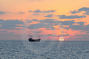Cargo ship and sunset.