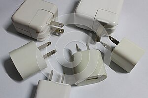 White plugs for charging smartphones