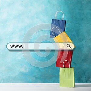 Online shopping. Search bar and colorful paper bags