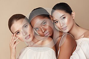 Beauty. Group Of Diversity Models Portrait. Multi-Ethnic Women With Different Skin Types Posing On Beige Background. Tender