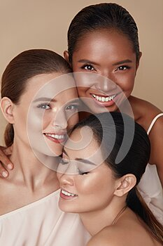 Diversity. Beauty Portrait Of Women. Multi-Ethnic Models With Natural Makeup And Perfect Skin Against Beige Background.