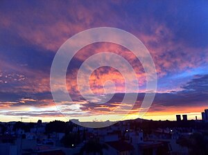 Sunset sky over town