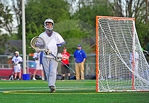 Lacrosse Goalie wiping his face