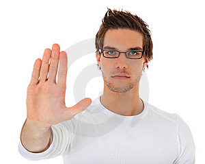 Young man with repelling gesture