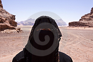 Portrait of Bedouin woman with burka in desert