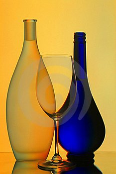Still life with wine glass and bottles