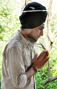 Praying sikh boy
