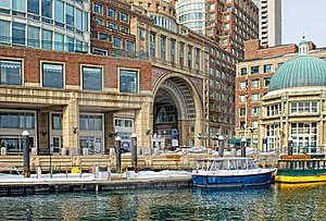 Water taxis inside historic rowes wharf in boston