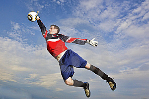 Goalie jumps to catch soccer ball