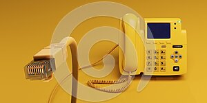 A Yellow VOIP Telephone and its Connector