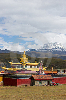 Golden temple with snow mountain