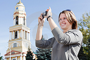 Woman photographing city's attractions