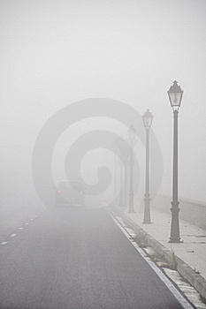 Car driving vanish into the fog