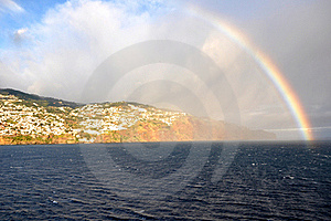 Rainbow over the sea and the island of Madeira