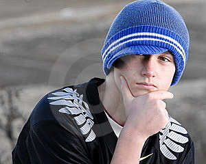 Thoughtful teenage boy with cap