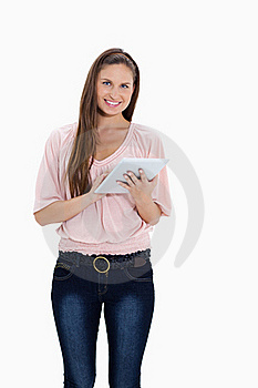 Smiling girl using a touchpad