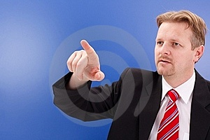 Business man pointing on copy space