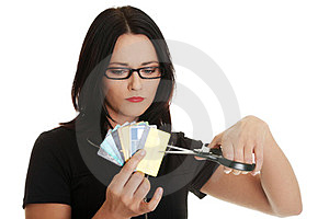 Sad young woman has to destroy her credit cards